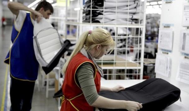 Workers prepare car upholstery in the Prevent factory in Gorazde